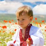 3702815 - boy in traditional clothes in flowers